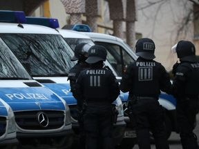 Police stand guard outside the Bilal mosque in Frankfurt