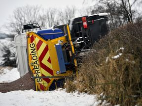 An overturned gritting lorry near Balfron Station on February 23, 2017 in Balfron, Scotland. Travel disruption is affecting many parts of Scotland as Storm Doris arrived. The Met Office has issued an amber weather warning for snow for large parts of the country