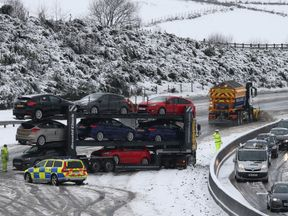 A jack-knifed car transporter near Banknock on the M80