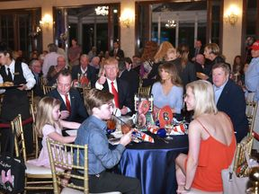 US President Donald Trump watches the Super Bowl with First Lady Melania Trump (R) and White House Chief of Staff Reince Priebus (L) at Trump International Golf Club Palm Beach in West Palm Beach, Florida on February 5, 2017. / AFP / MANDEL NGAN (Photo credit should read MANDEL NGAN/AFP/Getty Images)