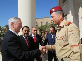 Iraqi Chief of Staff General Othman al-Ghanimi welcomes U.S. Defense Secretary Jim Mattis