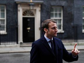 Emmanuel Macron speaks to media outside Number 10