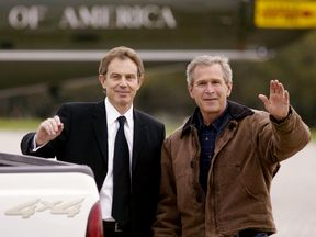 US president George W Bush (R) waves with British PM Tony Blair (L) in 2002