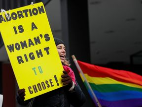 An anti-Trump demonstrator protesting at an abortion rights rally in Chicago