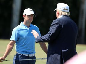 DORAL, FL - MARCH 06: Republican presidential candidate Donald Trump makes an appearance prior to the start of play and speaks with golfer Rory McIlroy of Northern Ireland during the final round of the World Golf Championships-Cadillac Championship at Trump National Doral Blue Monster Course on March 6, 2016 in Doral, Florida. (Photo by Mike Ehrmann/Getty Images)