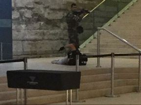 A soldier stands over the injured attacker