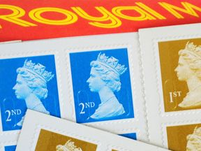 File photo dated 27/03/12 of first and second-class stamps, as the Royal Mail announced that the price of stamps is to increase.