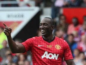 Dwight Yorke plays in a Manchester United legends match in 2013