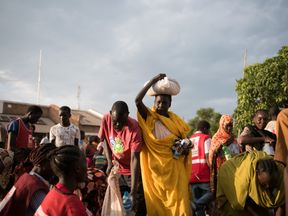 Refugee wait to be registered as displaced at a Red Cross centre in South Sudan