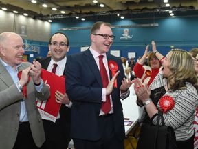 Gareth Snell celebrates with his wife after being named the new Labour MP in Stoke Central