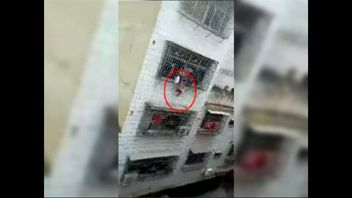A girl seen hanging from a window in China