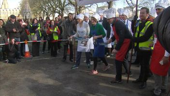 MPs take on the Lords and the media in the annual charity pancake race