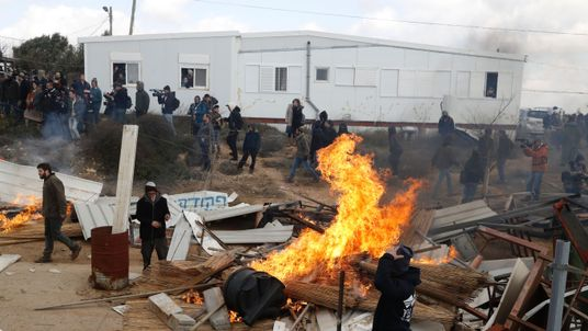 Israeli settlers set furniture on fire during scuffles with security forces
