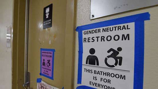 Signs are poseted outside the Santee High School's gender neutral toilets in LA