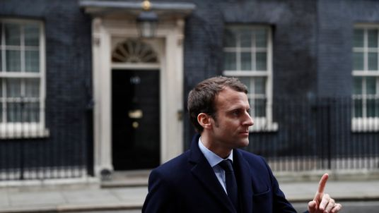 Emmanuel Macron speaks to media outside Number 10