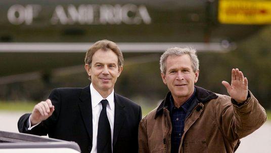 US president George W Bush (R) waves with British PM Tony Blair (L) in 2002