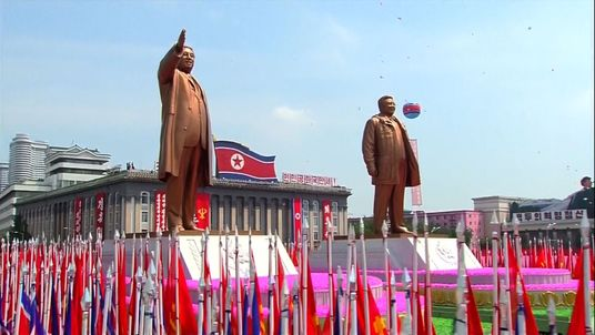Statues of North Koreas past Supreme Leaders are paraded through Pyongyang