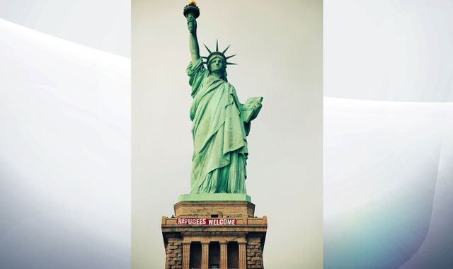 'Refugees Welcome' sign unfurled by activists on Statue Of Liberty in New York