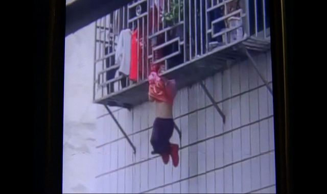 Video: Men save girl dangling from fourth-storey window in China