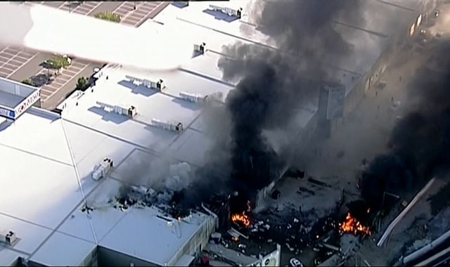 Plane carrying five people crashes into Melbourne shopping centre