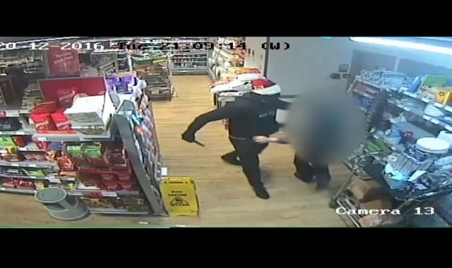 CCTV footage shows Santa hat robber holding up Co-op store with kitchen knife