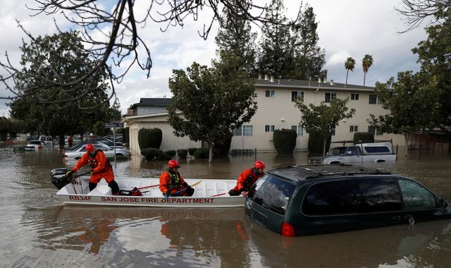 San Jose Homeless Encampment Residents Stranded By Flooding, Rescued By Fire Department