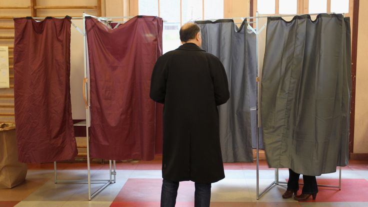 Voting at a polling station in Paris in the 2012 presidential election