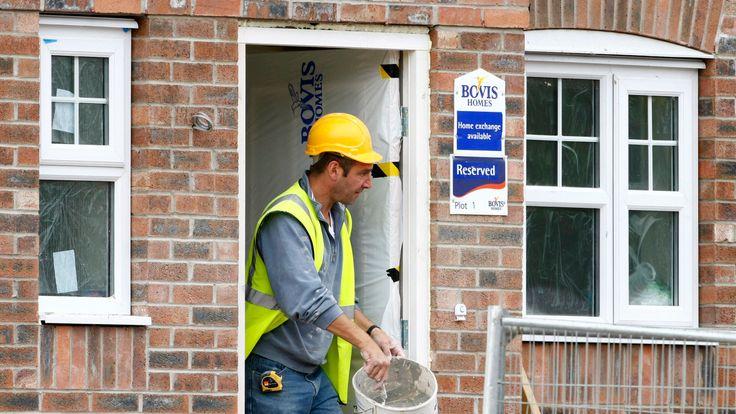 A builder works at a Bovis homes housing development near Bolton, Britain, July 9, 2008.