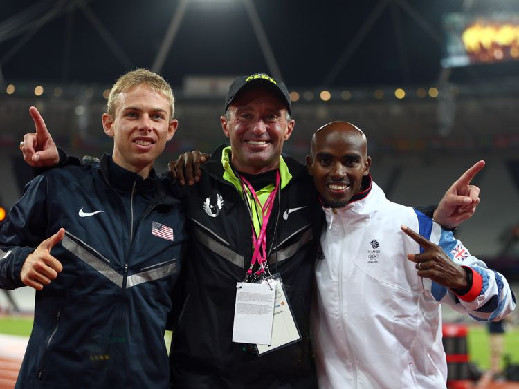 Mo Farah of Great Britain celebrates winning gold with silver medalist Galen Rupp of the United States and (C) coach Alberto Salazar after the Men's 10,000m Final on Day 8 of the London 2012 Olympic Games at Olympic Stadium on August 4, 2012 in London, England