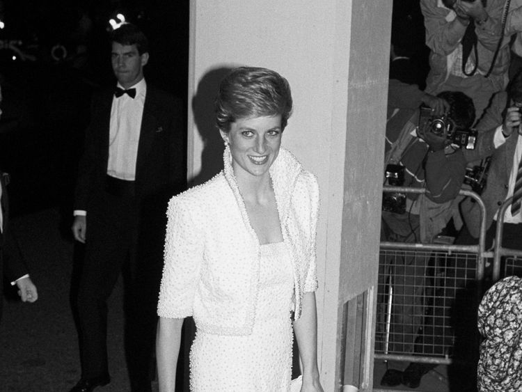 Diana in a white silk crepe dress and jacket by Catherine Walker on a visit to Hong Kong in 1989