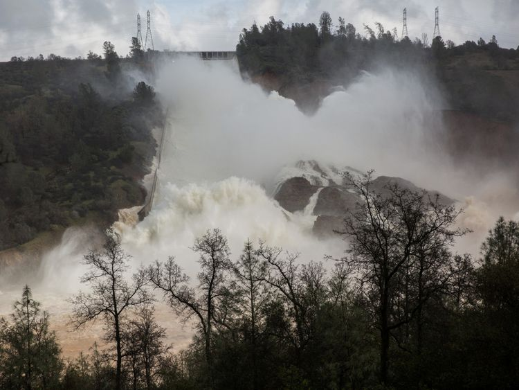 65,000 cfs of water flow through a damaged spillway on the Oroville Dam