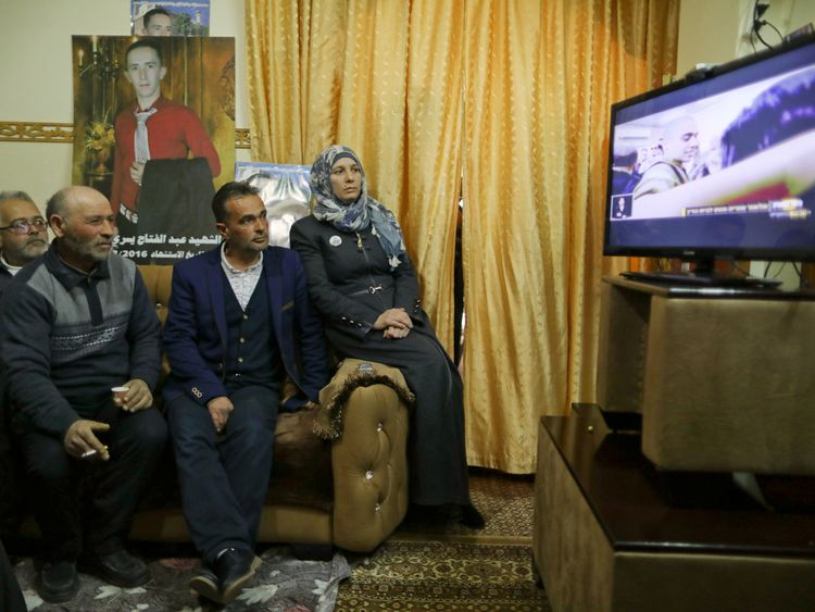 The family of Abd Elfatah Ashareef watch the TV broadcast of the sentencing