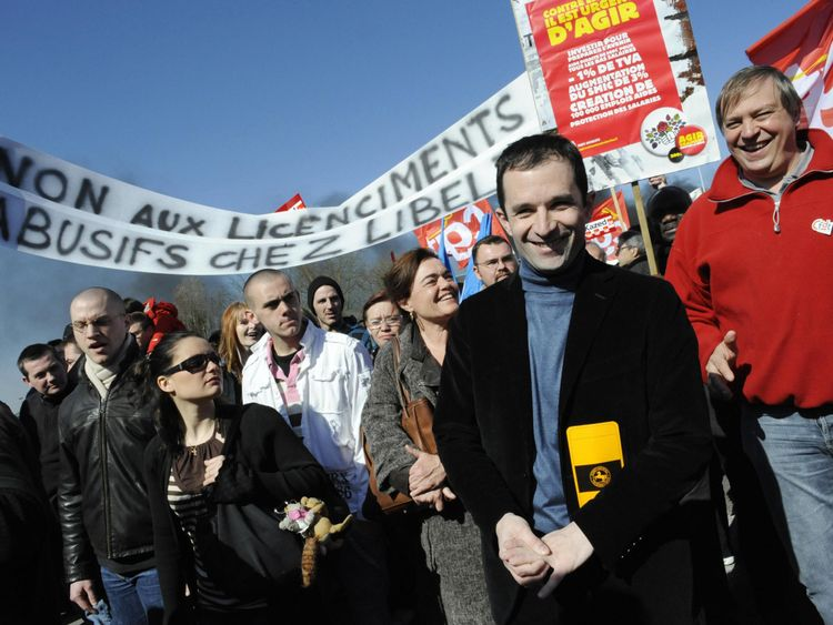 The Socialist nominee attends a workers' protest for higher wages in Paris