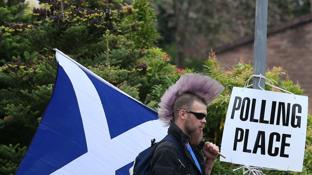 File photo dated 18/9/2014 of Chris McAleese walks by a polling sign at Bannockburn Polling Station, as voters go to the polls in the Scottish Referendum. The Scottish First Minister Nicola Sturgeon said a new independence referendum should be held between autumn 2018 and spring 2019.