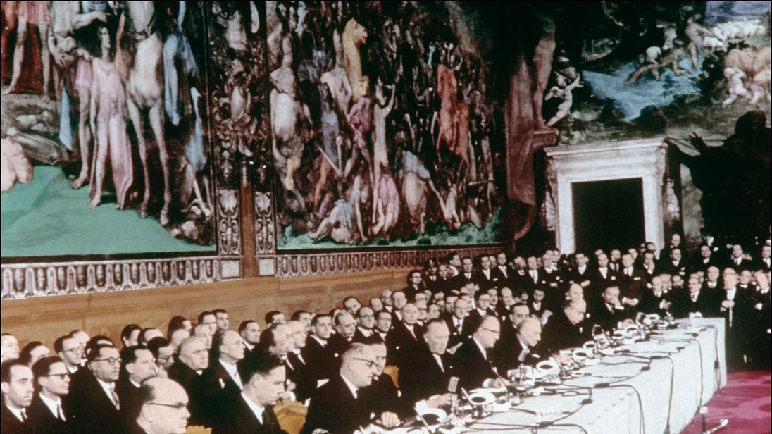 Ministers sign the treaty to form the European Economic Community (EEC) on March 25, 1957.