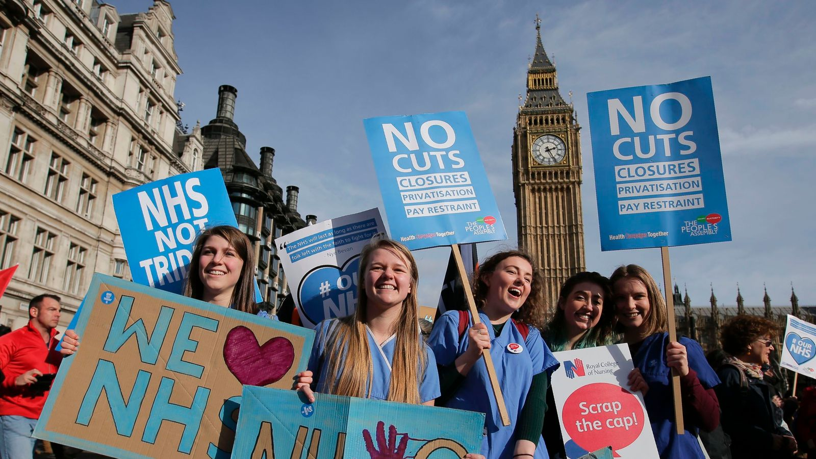 Protesters gather in Westminster during a demonstration in support of the NHS