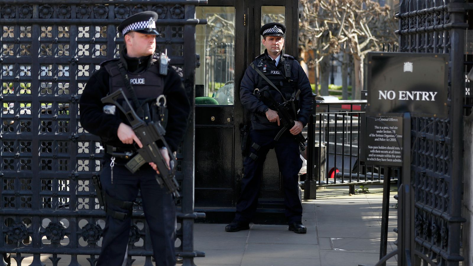 Armed police officers stand at the Carriage Gates entrance to the Houses of Parliament, following the attack in Westminster earlier in the week, in London, Britain March 25, 2017. REUTERS/Peter Nicholls