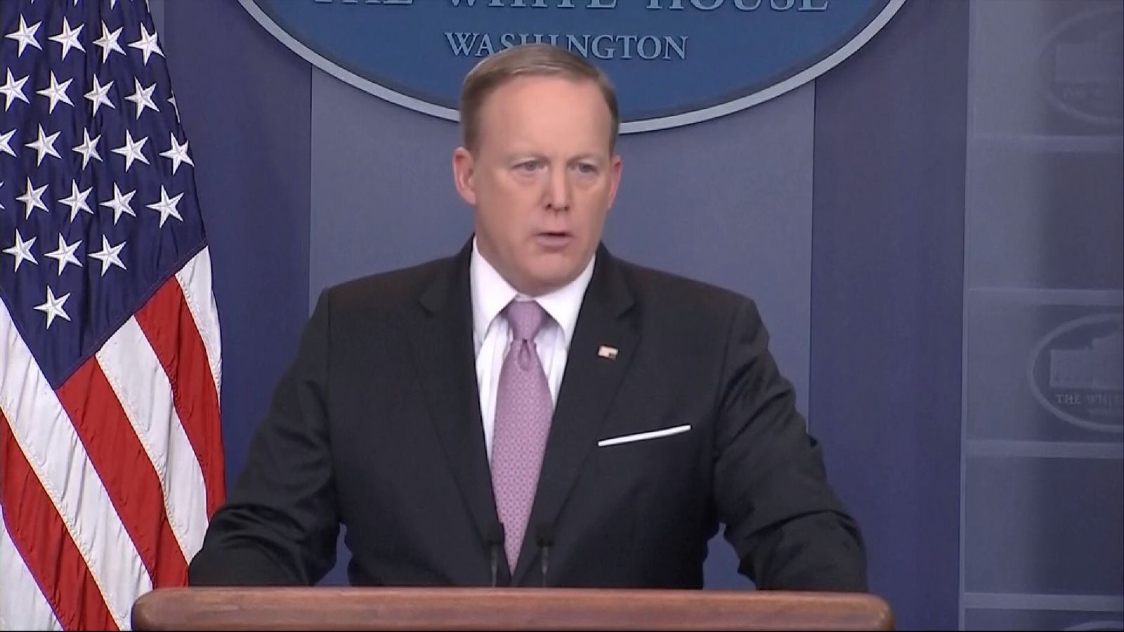Sean Spicer wears his US flag pin upside-down