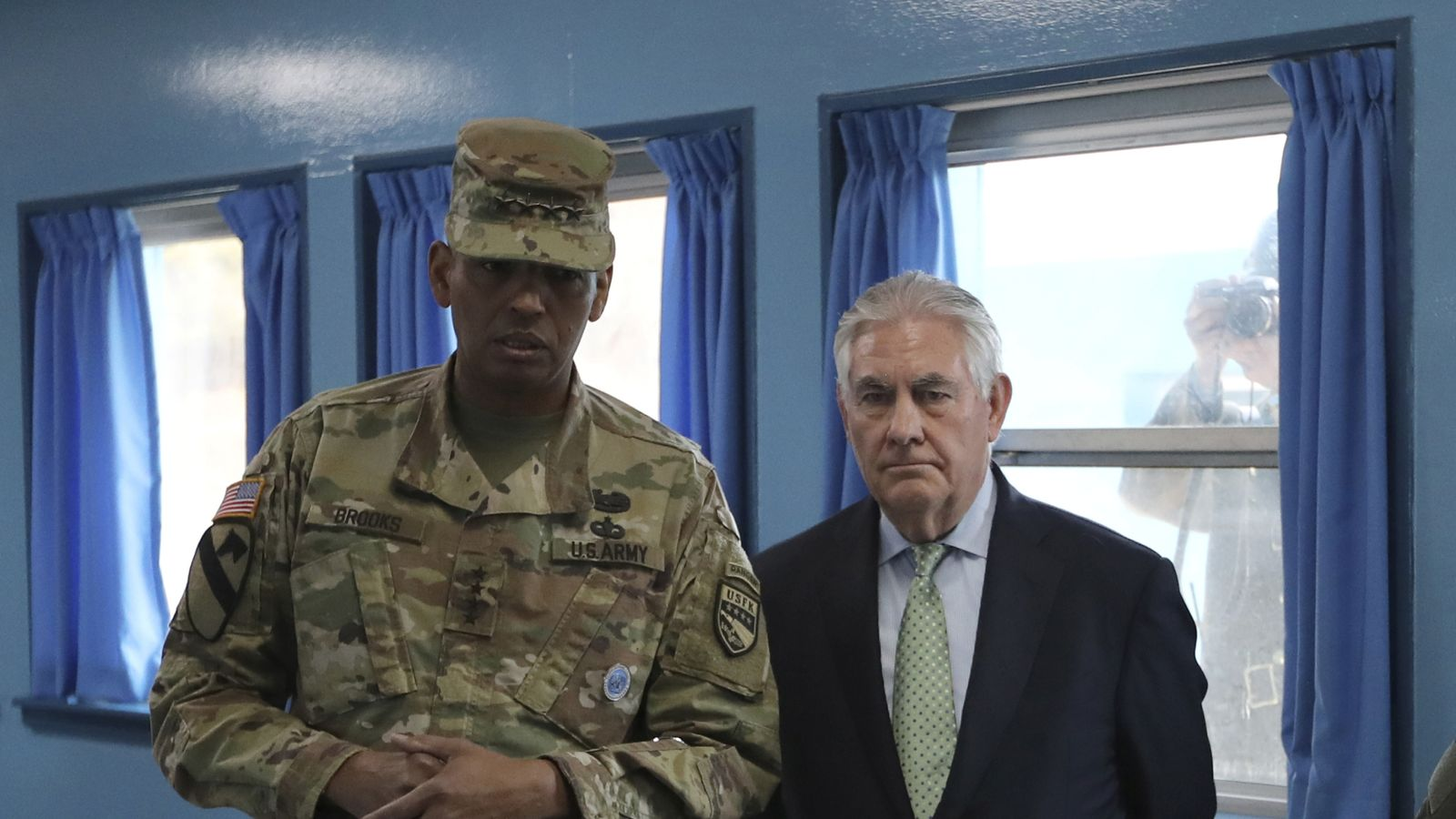 Mr Tillerson snapped by a North Korean soldier at the border village of Panmunjom