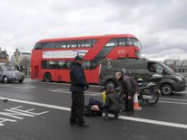Injured people are assisted after an incident on Westminster Bridge