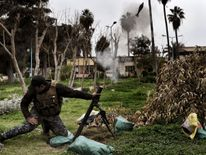 A member of the Iraqi security forces fires mortars towards jihadists positions in west Mosul