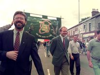 Gerry Adams and Martin McGuinness lead a Republican parade in Belfast, commemorating 25 years of British troops on the streets of Northern Ireland, 1994