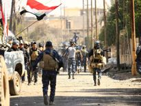 Iraqi forces storm an area of west Mosul as they push to oust IS fighters
