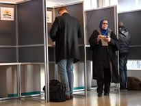 People cast their votes in the Dutch parliamentary elections