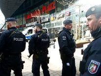 Armed police outside the shopping mall in Essen, western Germany