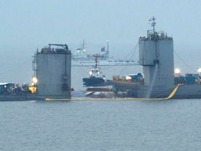 Barges continue to salvage the sunken Sewol ferry in South Korea