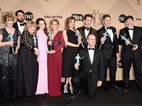 The cast of Downton Abbey pictured after winning Outstanding Performance By an Ensemble in a Drama Series at The 22nd Annual Screen Actors Guild Awards in Los Angeles, California