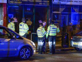 Police raid a property in Birmingham