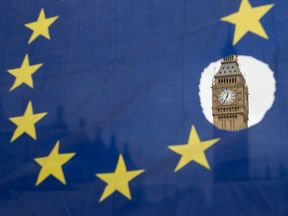 Big Ben is seen through an EU flag with a hole removed as the UK leaves