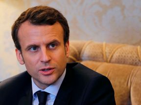 French presidential election candidate for the 'En Marche !' movement Emmanuel Macron attends a meeting with the former US secretary of state, on international affairs and the upcoming presidential election in France, on March 3, 2017, in Paris. Macron met with former US secretary of state John Kerry